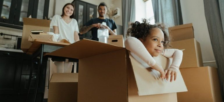 a family packing for the move, representing manhattan residential movers