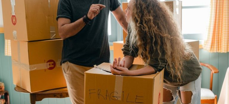 a couple preparing boxes for the move, representing clinton movers