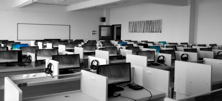 A call center in an office with lots of desks.