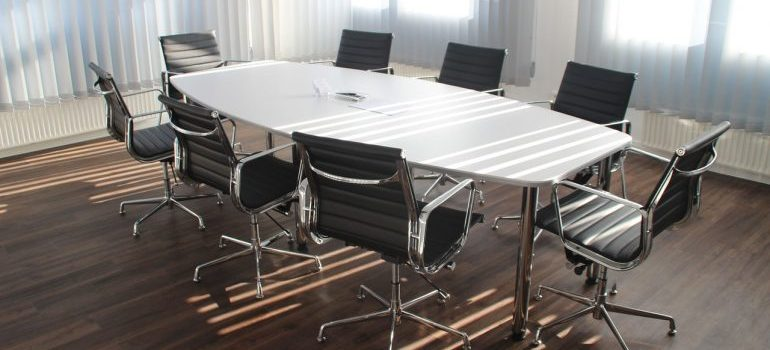 An empty conference room, ready to be relocated by commercial movers Queens offers.