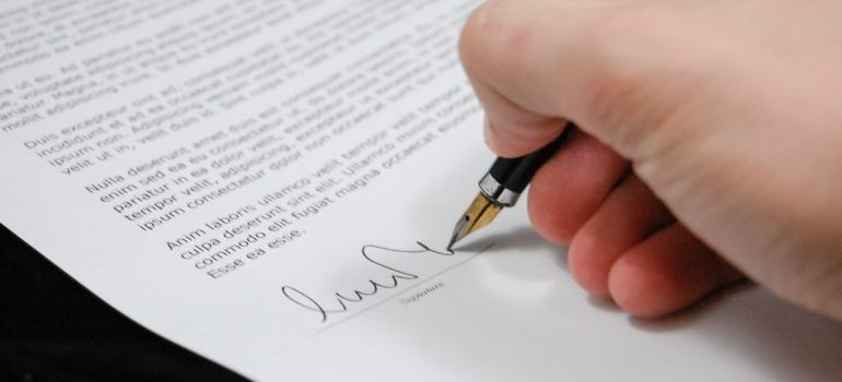 A person signing a document