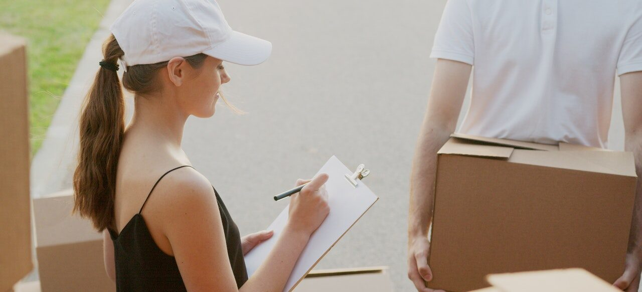 Two experienced movers completing moving tasks.