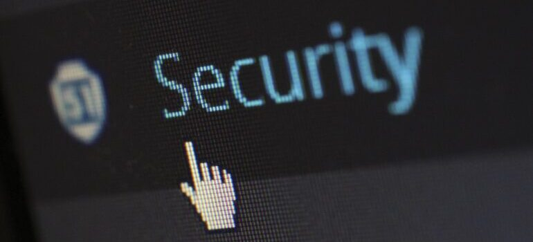 A mouse cursor pointed on a security button on a website