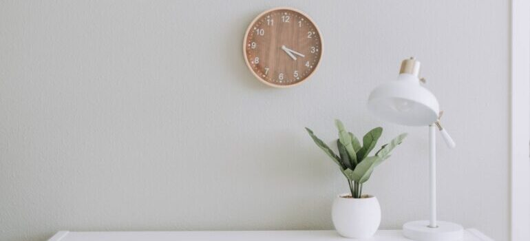 minimalistic office with a prominent clock on the wall