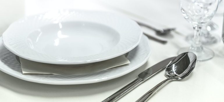 A plate set on white linen.