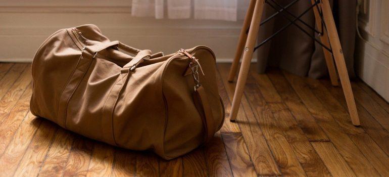 A duffel bag on a wooden floor.