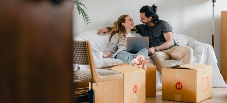 A happy couple preparing for a move.