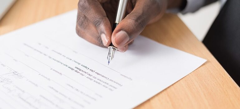 man signing papers