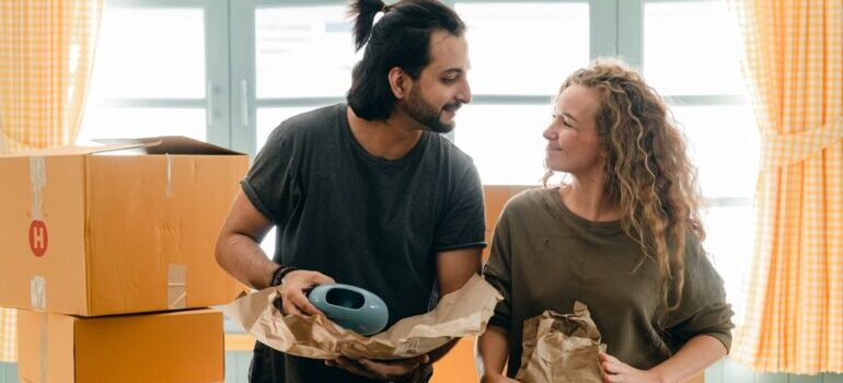 A couple packing for a move - Morningside Heights movers