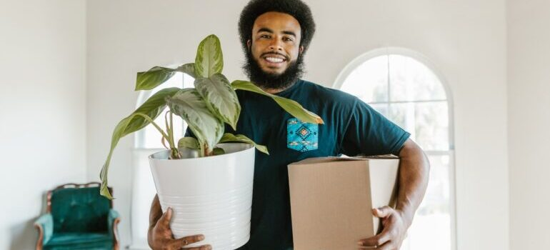 NYC movers taking out plants and boxes