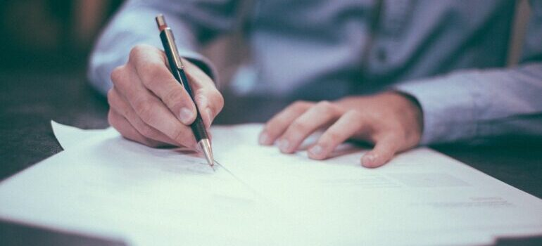 a man signing the paper
