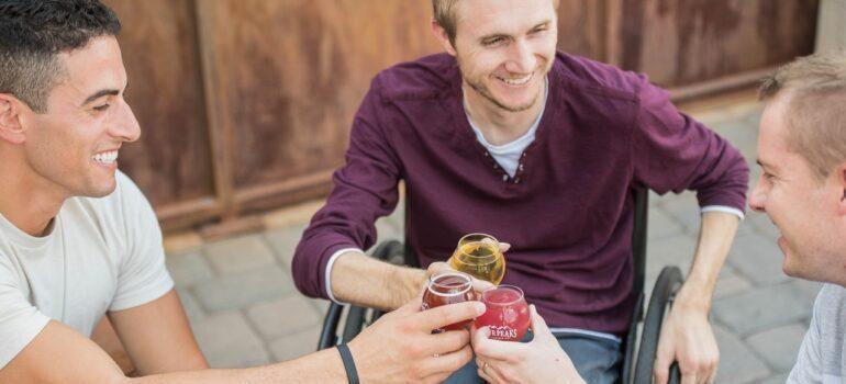 Three men having drinks.