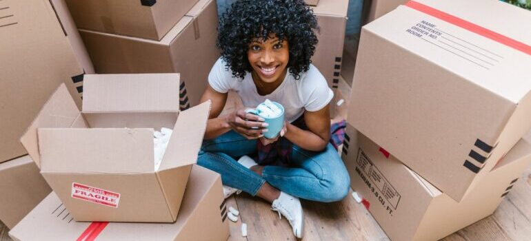 A girl with cardboard boxes