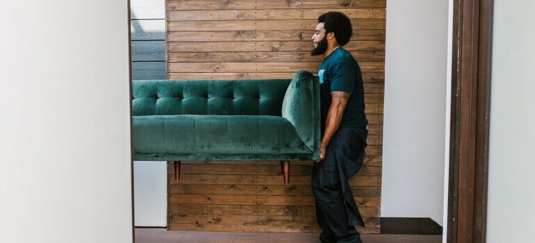 mover carrying a sofa