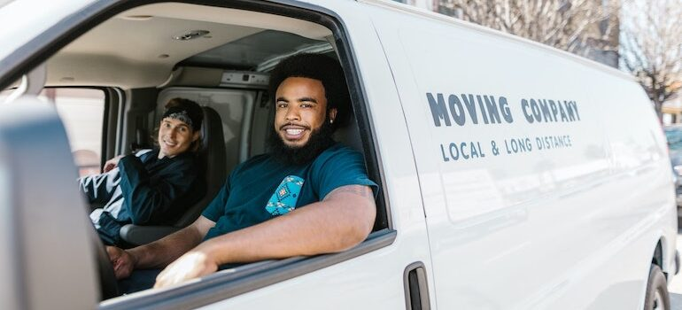 two man in a van are a working for movers Sunset Park