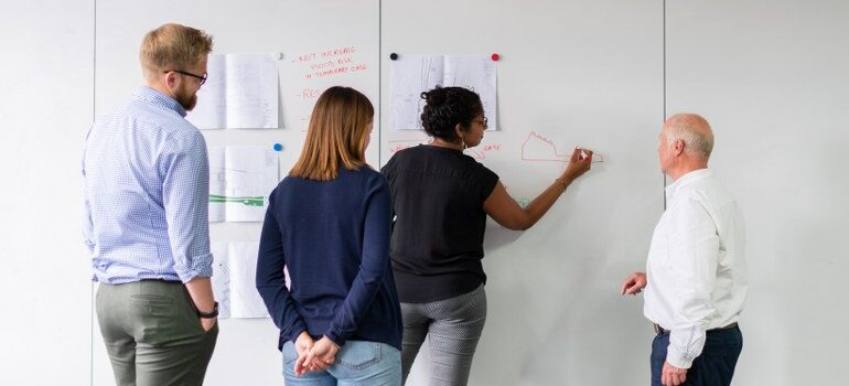 a team drawing on a whiteboard