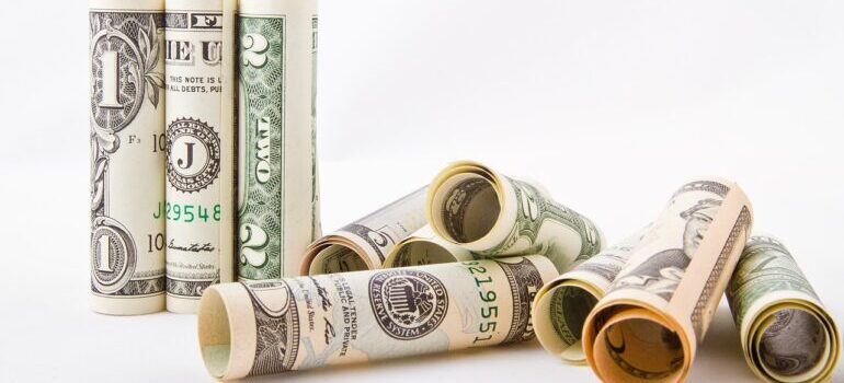 Rolled up dollar bills to pay for movers Jamaica NY.