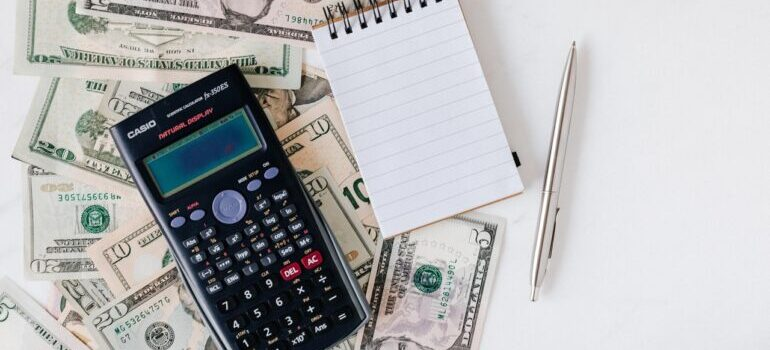 Calculator, notepad, and money