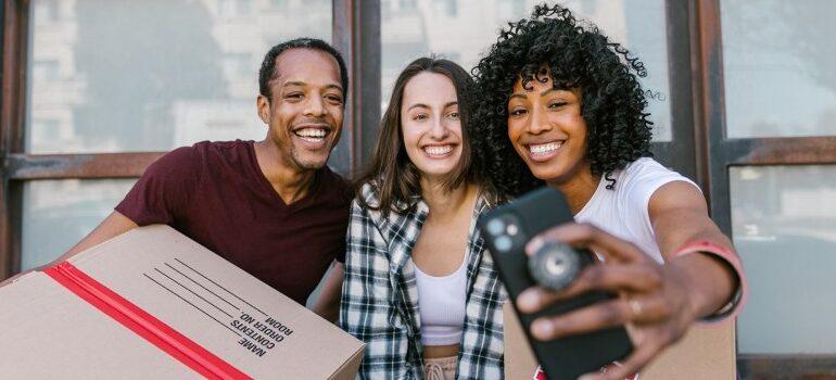 three people taking a selfie