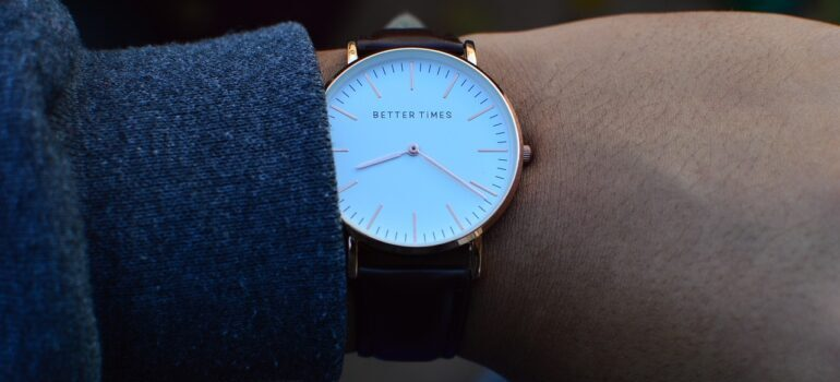 A close up of a person wearing a wrist watch.