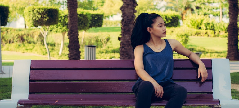 A woman is sitting on a bench.